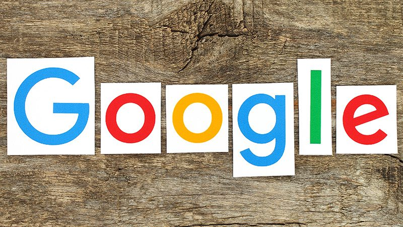 The Google logo, cut out and pasted to a piece of wood