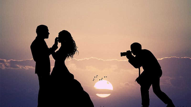 A wedding photograph, backlit by the sun